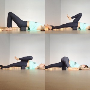 From your supported bridge pose, walk the feet in and bend the knees. Scoot the hips over to the right so that the left hip is on the block and the right is hovering off. Open the arms wide like a T and extend the left leg forward and draw the right into the chest. On an exhale, take the right leg across the body to the left side. Gaze can go to the left if the neck feels okay here.